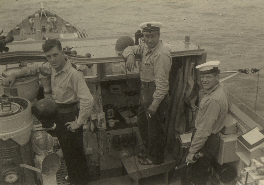 HMS Concord rushing to the assistance of the stricken ML. Visible in this picutre is the officer of the watch, Yeoman of Signals Vine, and Signalman A.L. Perryman