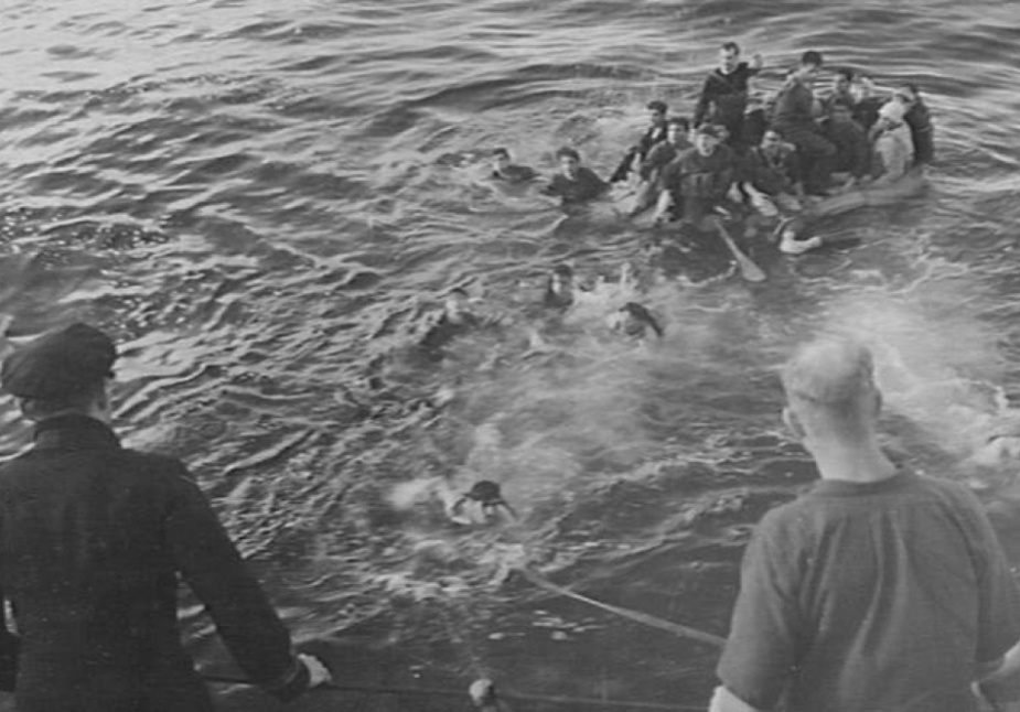Vampire's crew rescuing survivors from the Italian destroyer Artigliere. Twenty-two men including, one officer, were recovered and a plain language signal sent to the Italian Admiralty advising it of the position of rafts with other survivors on board. Many of them were later rescued by their own people.