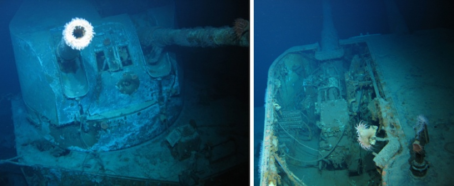 'B' turret also showed signs of extensive damage. A large part of the turret 'deck head' (roof) was blown away and there was clear signs of armour piercing shell damage to the supporting barbette. Note that in these images the lower sighting ports are open, suggesting that the turret may have been operating in local control. The right hand sighting port (as viewed) is where a gun-layer rating would sit. The remains of his Ross pattern monocular telescope can be seen through the apeture. The left hand sighti