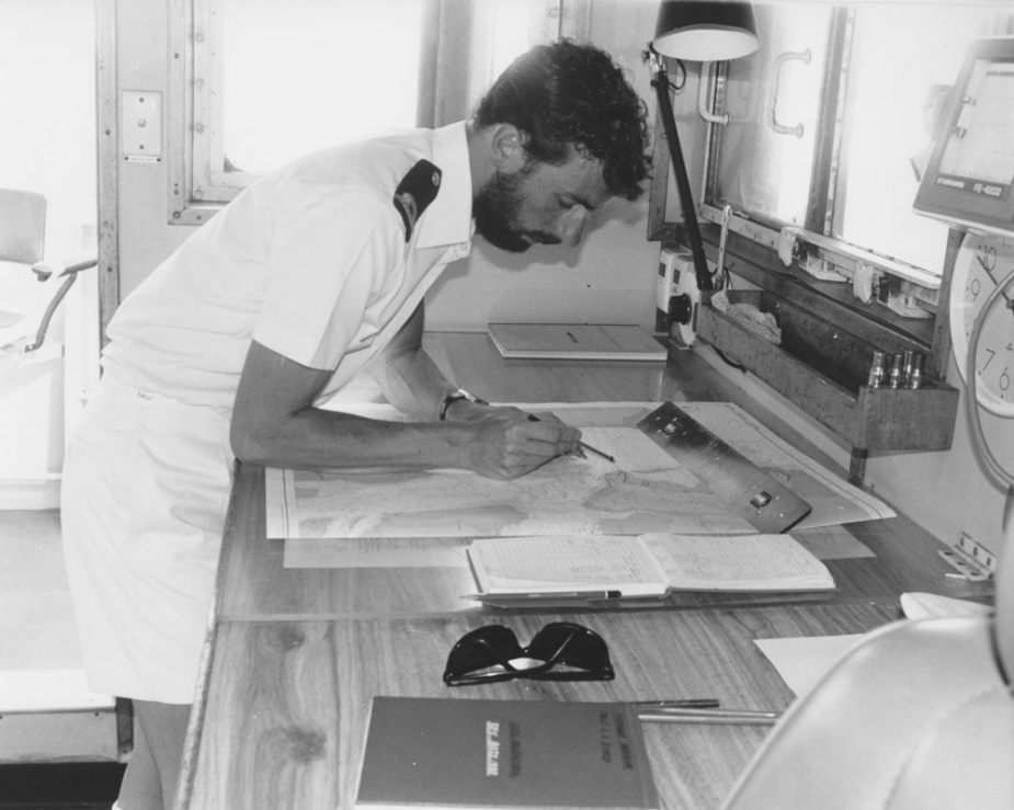 Navigator Sub Lieutenant Rohan Schied plots Balikpapan's position as she approaches Darwin.