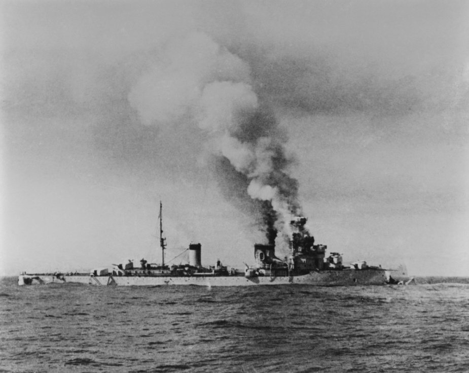 The crippled Italian cruiser Bartolomeo Colleoni.