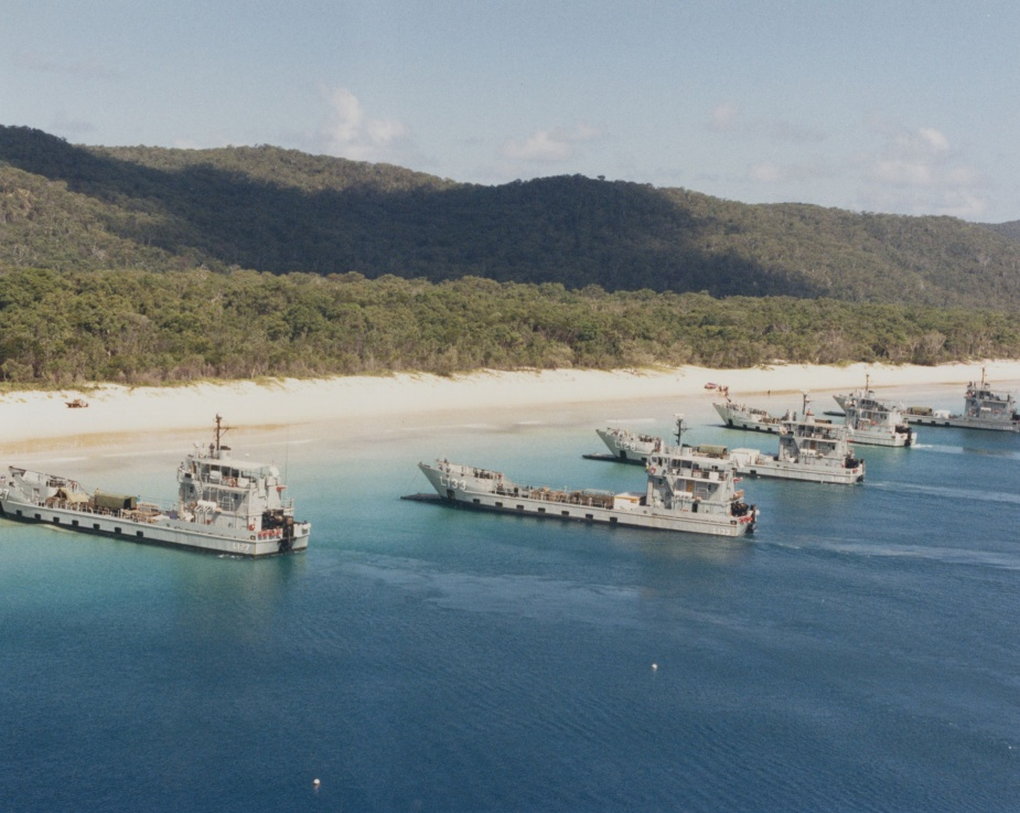 The RAN Amphibious Squadron conducting beaching operations in Queensland. L-R: HMA Ships Brunei, Betano, Labuan, Balikpapan and Tarakan