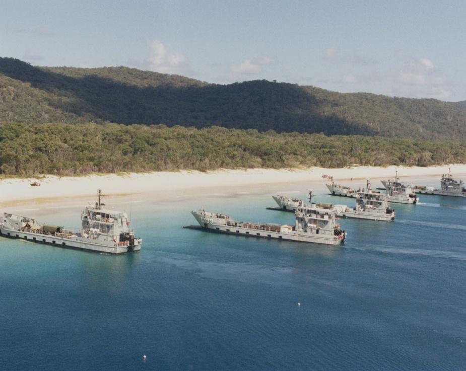 The RAN Amphibious Squadron conducting beaching operations in Queensland. From left: HMA Ships Brunei, Betano, Labuan, Balikpapan and Tarakan.