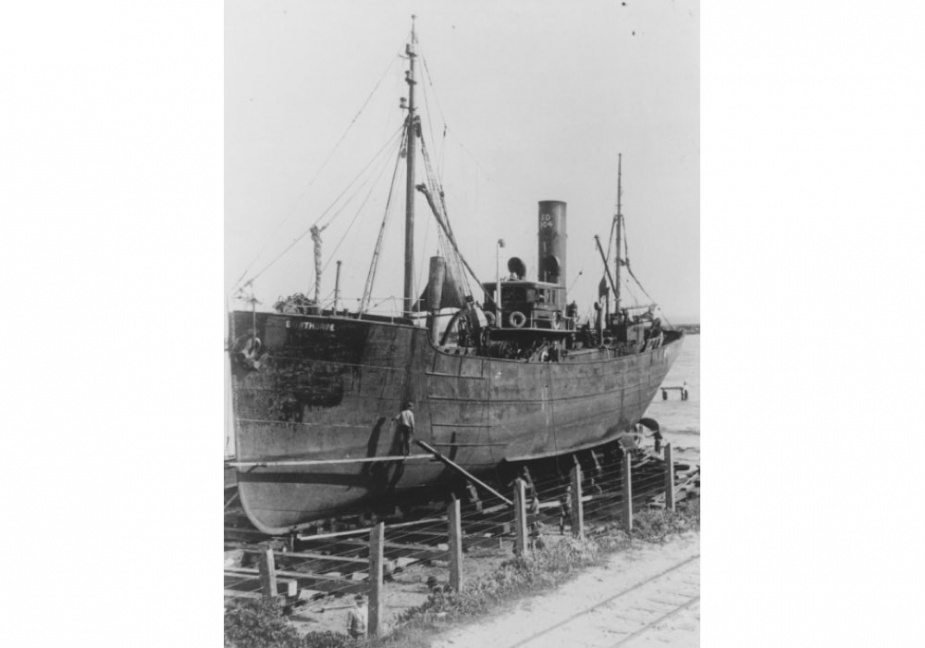 HMAS Bonthorpe undergoing maintenance on a slipway.