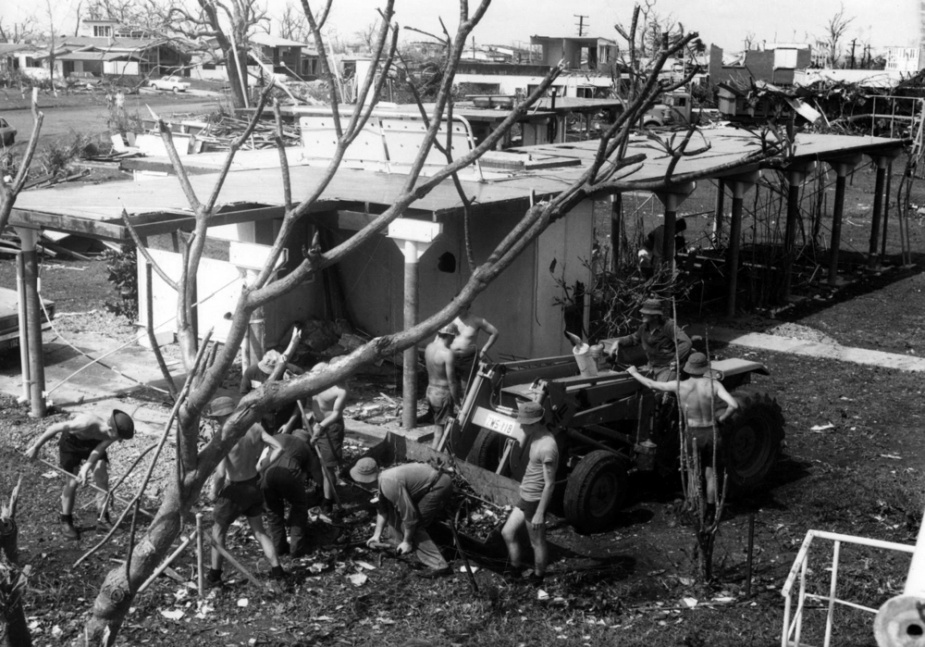 Sailors from HMAS Brisbane cleaning up the remains of a house after Cyclone Tracy, circa December 1974.