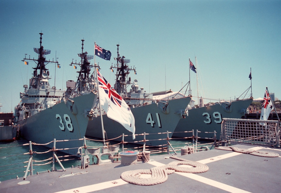HMAS Brisbane with her sister ships Hobart and Perth alongside.