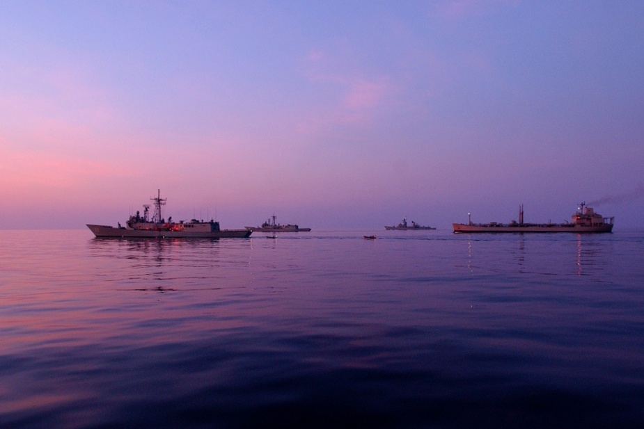 HMA Ships Canberra, Adelaide, Brisbane and Westralia conduct boat transfers in the early morning.