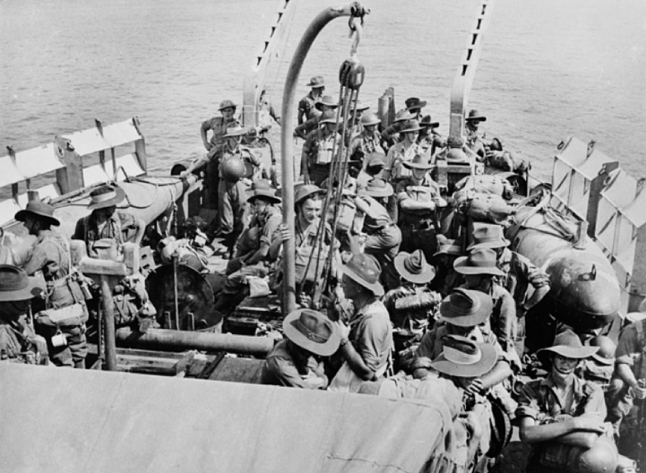 Troops from the 2/9th Battalion AIF on the quarterdeck of Broome, en route from Milne Bay to the Buna Area, c. December 1942 (A.J. Davies - AWM 305243).