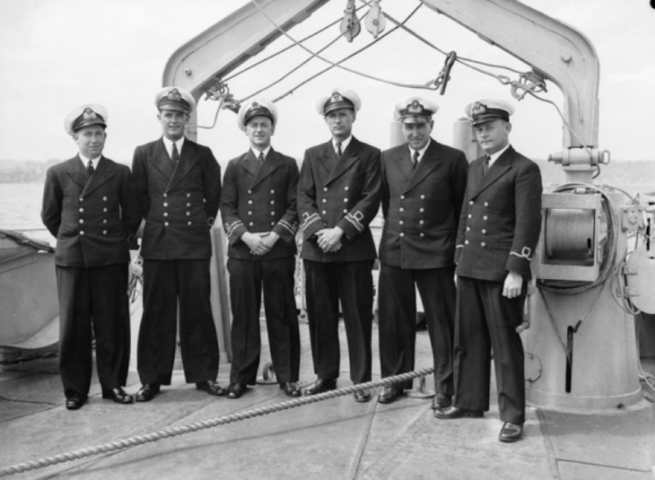 Officers of Bundaberg's wardroom pose for a formal photograph onboard.