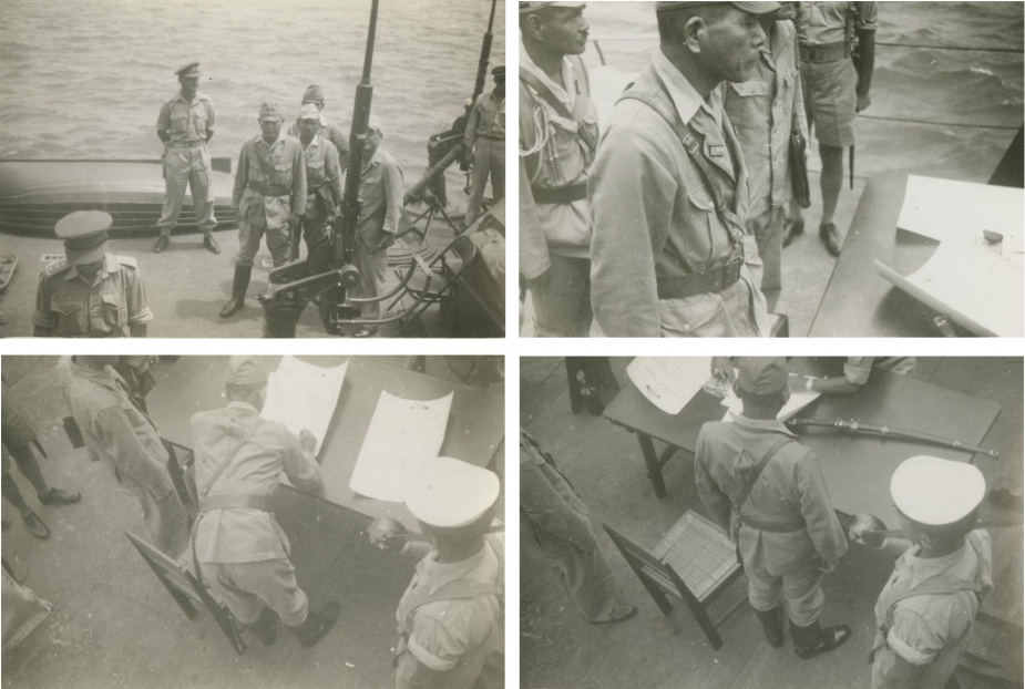 Vice Admiral Kamada is escorted on board Burdekin to sign the instrument of surrender.