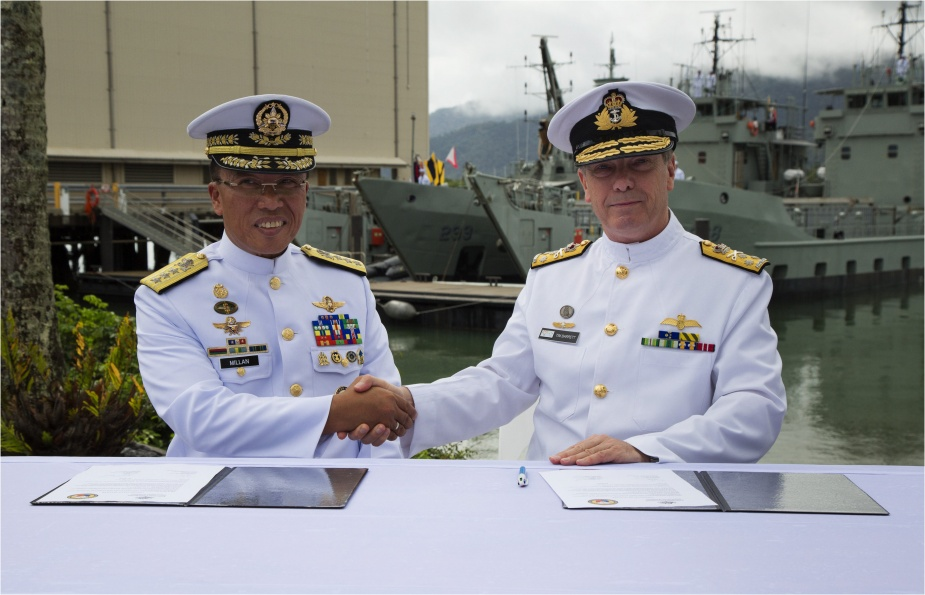 Vice Admiral Tim Barrett, AO, CSC, RAN, shakes hands with Vice Admiral Jesus Millan, AFP, Flag Officer in-Command Philippine Navy, after signing the official documentation for the Australian government to gift two decommissioned Landing Craft Heavy to the Government of the Philippines.