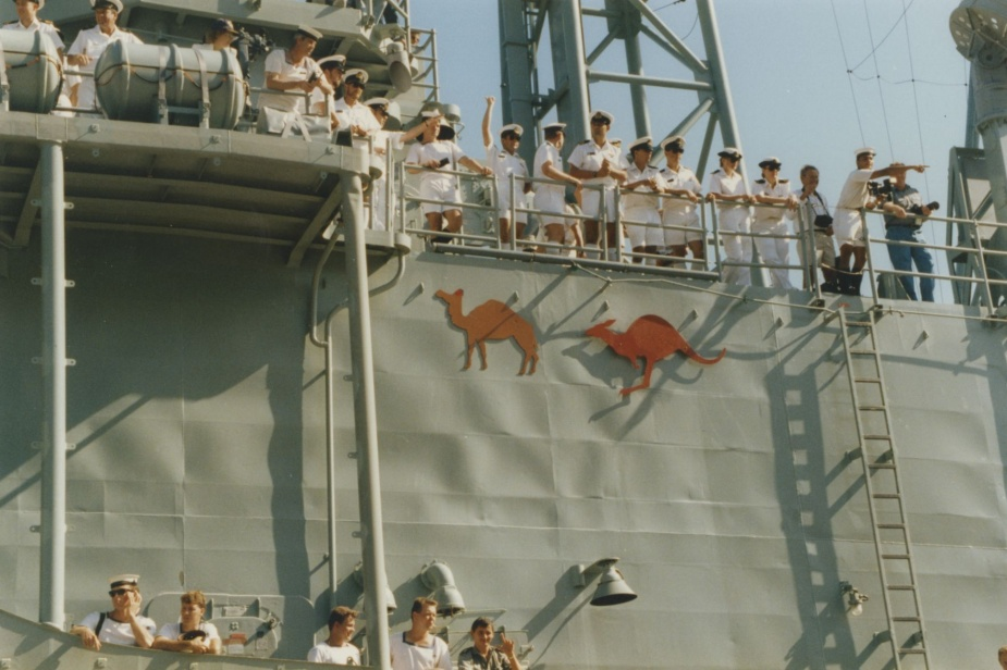 In a departure from normal convention the crew of HMAS Canberra (II) temporarily added the silhouette of a camel to the ship's superstructure to denote her return from service in the Middle East.