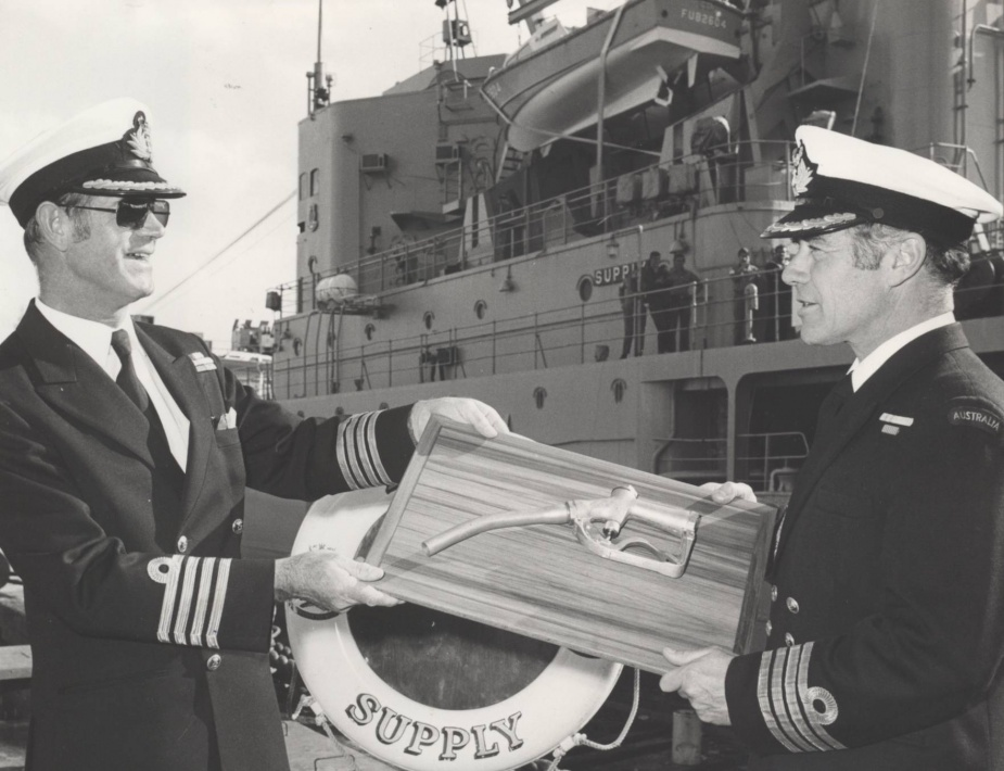 Captain JB Snow hands over the 'bowser' to Captain DJ Martin on rescinding command of Supply on 7 August 1978.