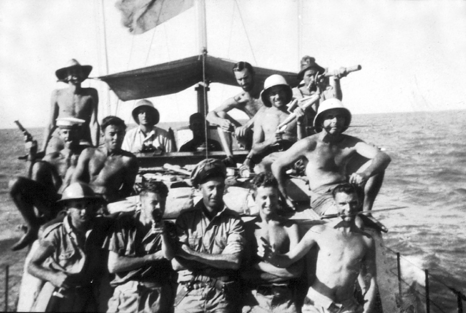 ML 814's crew looking more like pirates in the Gulf of Carpentaria. Top row, left - right: D Kelly, R Lewis, D Kay, J Nelson, J Old, R Hayes. Middle row: R Ling, T Trewick, J Livingstone. Front row: M C Hordern, Brewer, Chips Wood, D Partridge, G Constable.