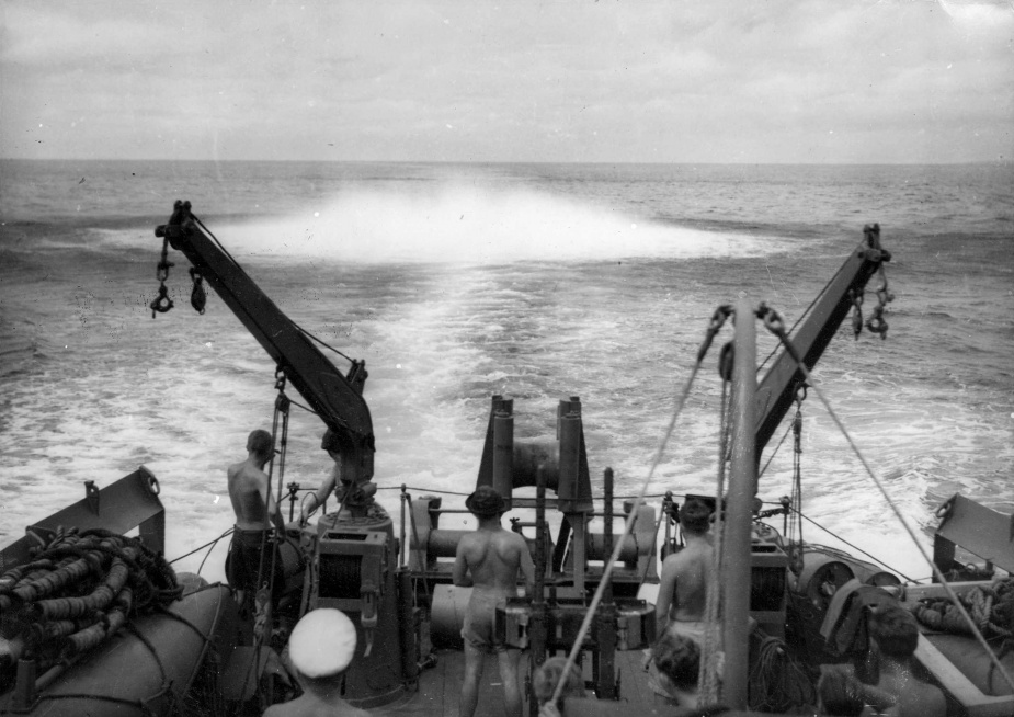 A depth charge exploding in the ship's wake