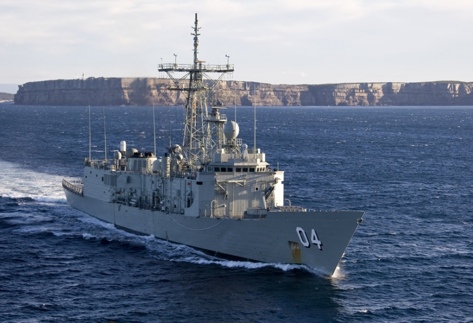 HMAS Darwin FFG 04 (Commanding Officer, Commander Craig Powell, RAN) sails out from Jervis Bay, NSW, passing Point Perpendicular, as the ship heads for sea in the Eastern Australian Exercise Area (EAXA) to conduct FFG Upgrade Contractor Trials after being recently fitted with the new VLS (Vertical Launch System), 12 June 2008.