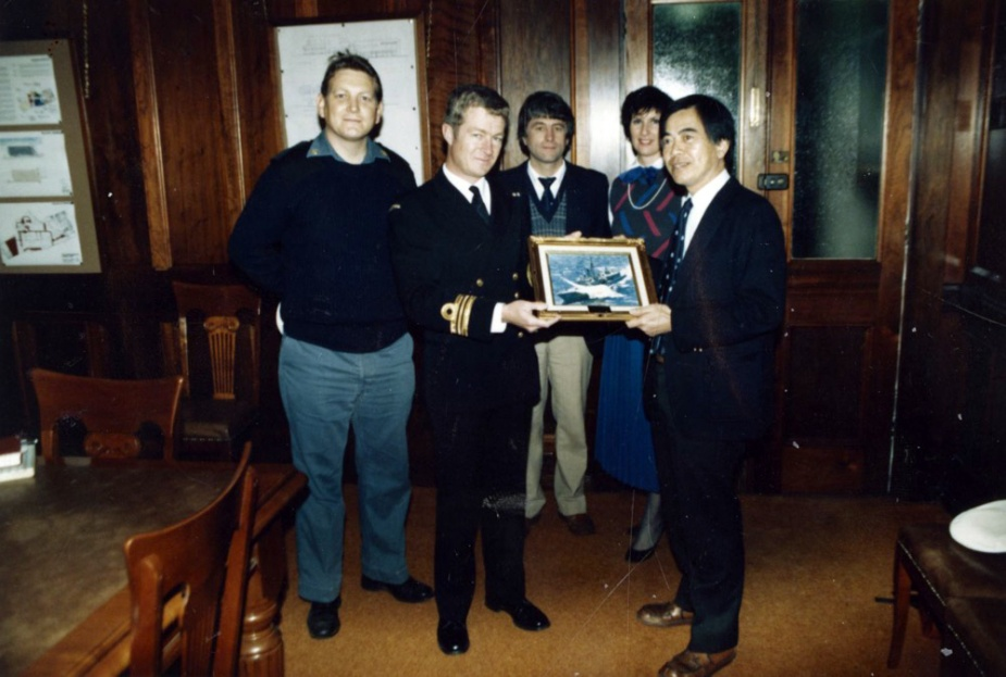 Members of Darwin's ship's company paid a visit to Sydney's Royal Alexandra Children's Hospital on 15 August 1986. The visit was to present a photograph of the ship to the General Medical Superintendent of the hospital, Dr John Yu. Pictured is the Executive Officer, LCDR Lee Cordner, RAN, presenting the picture to Dr Yu, with CPO Ron Gregg looking on.