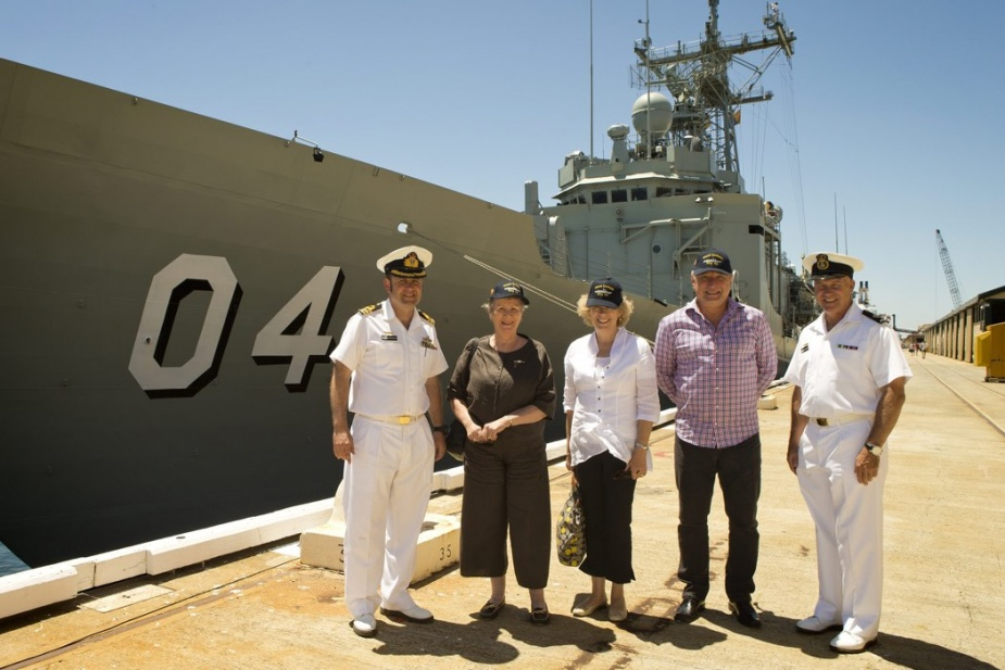 CO HMAS Darwin, CMDR Terence Morrison, RAN, HMAS Darwin's Launching Lady, Mrs Joan Johnston, OAM, Mrs Karen Hall, Jon Hall and Warrant Officer Peter Leech, with HMAS Darwin in the background at the Port of Fremantle, Western Australia, 28 January 2014.