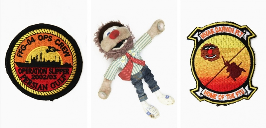 Left: Patch worn by members of the Operations Room Crew aboard Darwin during the war on Iraq, 2003. Middle: Mascot of Australian children's television character 'Agro' carried by the embarked Sikorsky S-70B Seahawks helicopter aboard Darwin during the war on Iraq 2003. The mascot, along with a Fosters beer mat, were displayed on the dash of the helicopter, to ensure that no confusion existed as to the nationality of the crew. The Seahawk itself was known among Coalition units as 'Agro'.