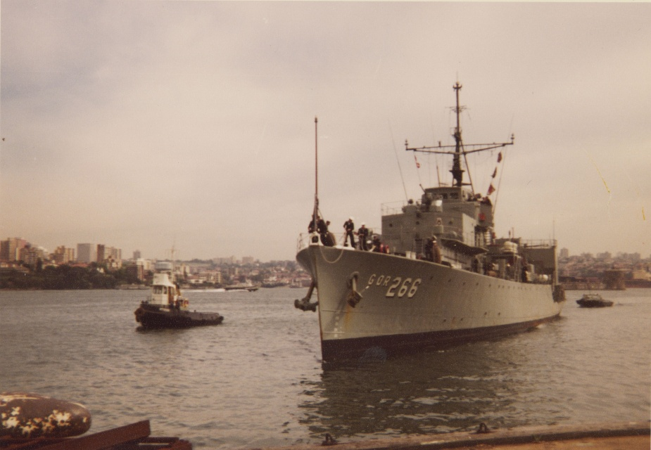 Diamantina prepares to come alongside Garden Island, Fort Denison can be seen in the background. c. 1977.