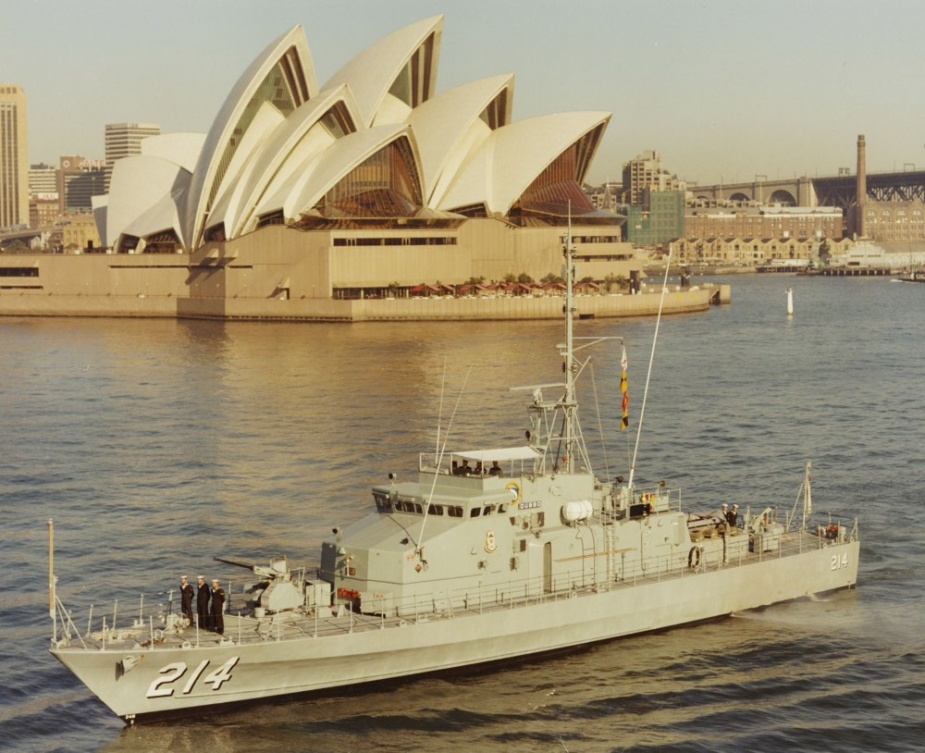 HMAS Dubbo in front of the Sydney Opera House in Sydney Harbour, NSW.
