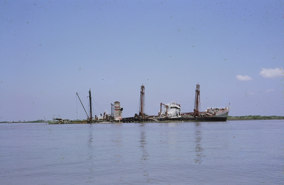 Eastern Mariner, ex-HMAS Bungaree, in the Saigon River after she struck a mine in 1966