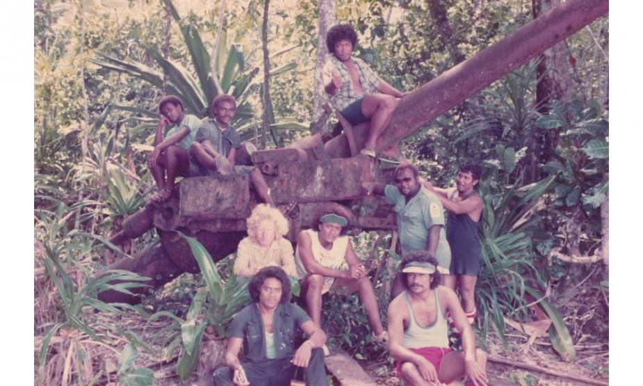 Senior Survey Year Honiara Technical Institute, Enoghae Harbour Survey, 1981 (Old Japanese 4 inch gun). (L-R) Front: Robin Daoe (Nauru), Atalea Kautoke (Tonga). Middle: Fana Patoro (Tuvalu), Fuata Mosese (Fiji), John Suga (master WAKIO), Robin Daoe (Nauru). Rear: Frank and Clifford (SIHU), Telua Sulaki (Tonga).