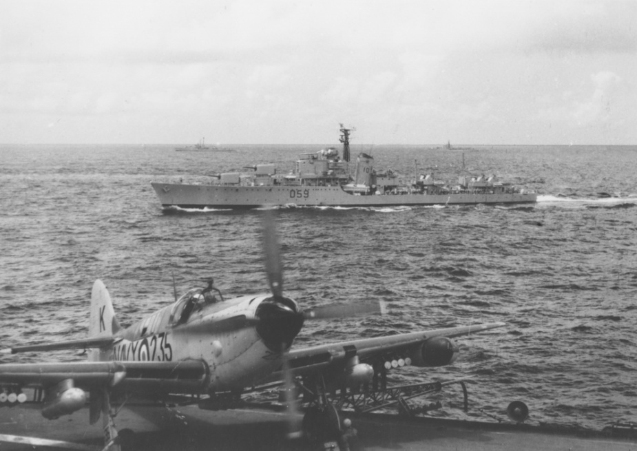 A Firefly on the deck HMAS Vengeance. HMAS Anzac is in the background.