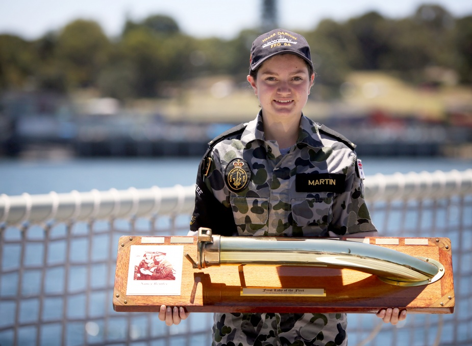 Seaman Combat Systems Operator Ashley Martin holds the First Lady of the Fleet Trophy, which was awarded to HMAS Darwin