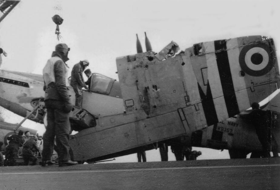 A flak-damaged Firefly aboard Sydney.