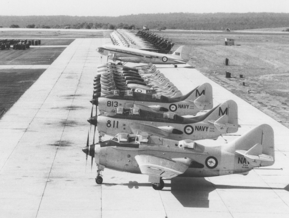 On the ground at NAS Nowra from front to back: Gannets, Sea Venoms, Sea Vampires, a Dakota and Wessex helicopters.
