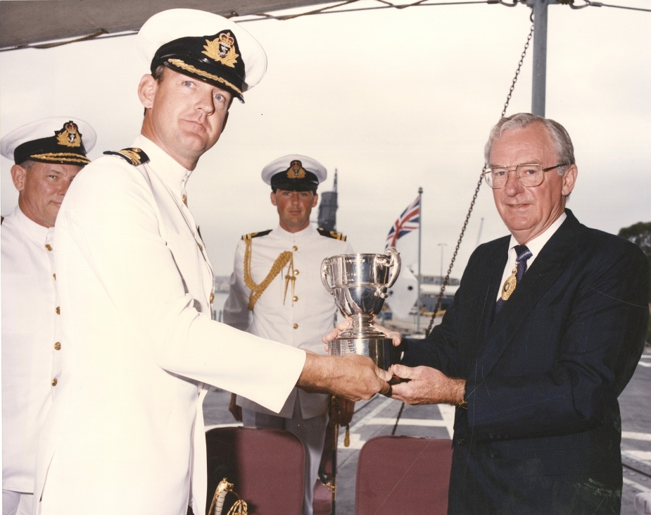 CMDR M Bell, RAN accepts the award of the Duke of Gloucester Cup from the Governor General the Honourable Bill Hayden, on behalf of HMAS Darwin's ship's company in 1995