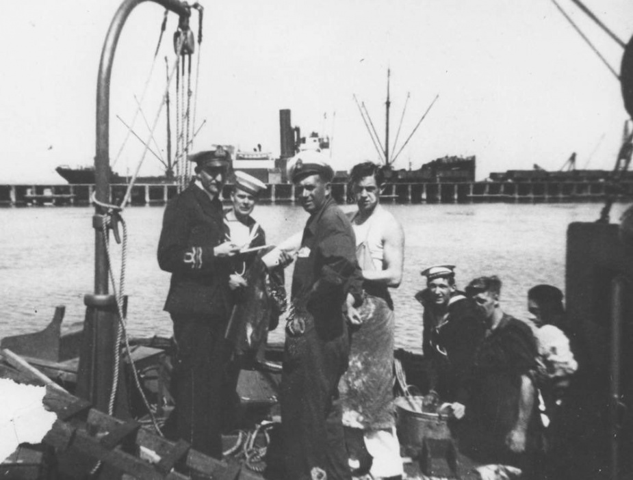 Lieutenant Commander Norman Trace, RANR, with members of Goorangai's crew prior to the ship commissioning in 1939.