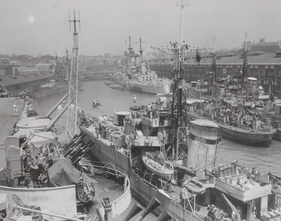 Ships of the British Pacific Fleet berthed at Wooloomooloo c.1945. In the foreground is the destroyer HMS Wessex. HMS King George V can be seen berthed at the Finger Wharf in the background. (State Library of Victoria)