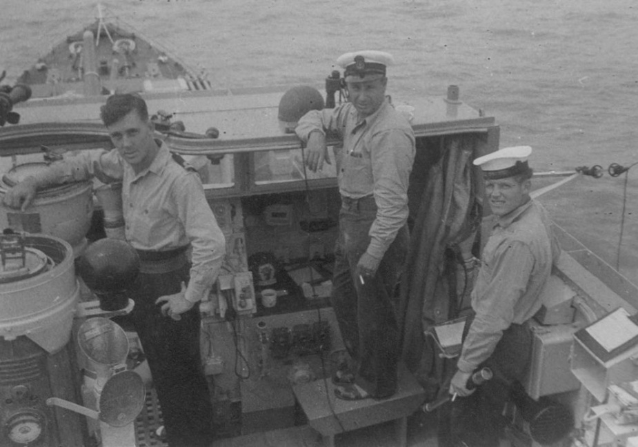 HMS Concord rushing to the assistance of the stricken ML. Visible in this picture is the Officer of the Watch, Yeoman of Signals Vine, and Signalman AL Perryman.