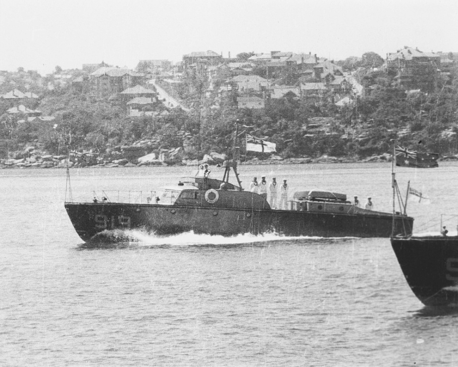 HMAS Air Master underway and dressed with masthead ensign in Sydney Harbour.