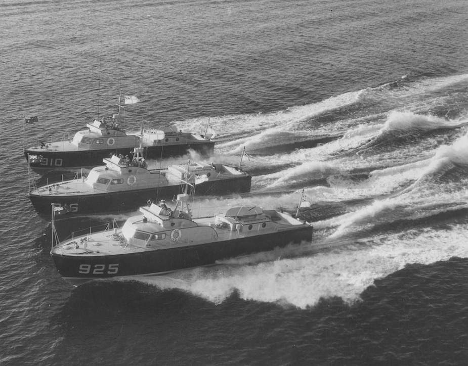 HMA Ships Air Mercy, Air Trail & Air Speed in close formation and proceeding at high speed. Each vessel is dressed with mastheads ensigns and the Australian National Flag on the jackstaff