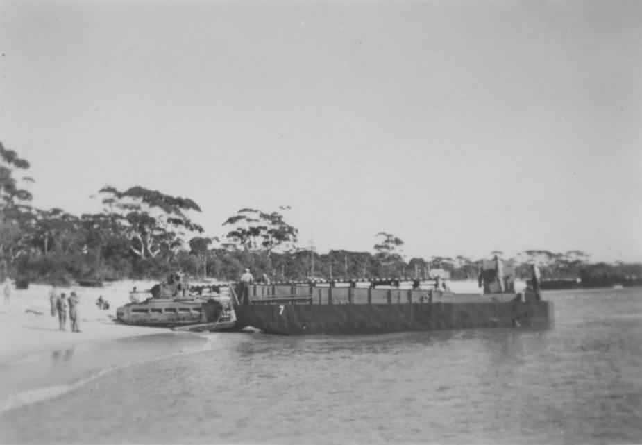 A Matilda tank rolls off a landing craft at Shoal Bay.