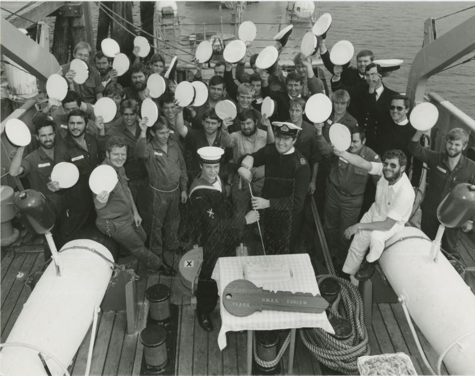 Ship's company celebrate the twenty-first birthday of HMAS Curlew