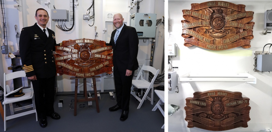 Captain John Stavridis accepts HMAS Hobart (III)'s completed battle honour boards from Mr Yates.