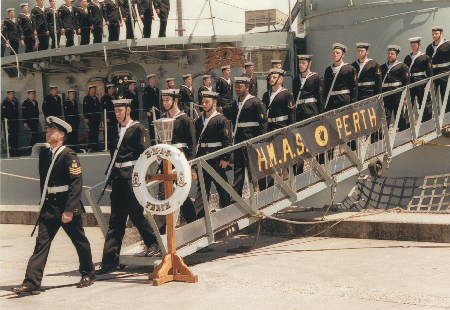 HMAS Perth's ship's company ceremoniously leaving the ship for the last time