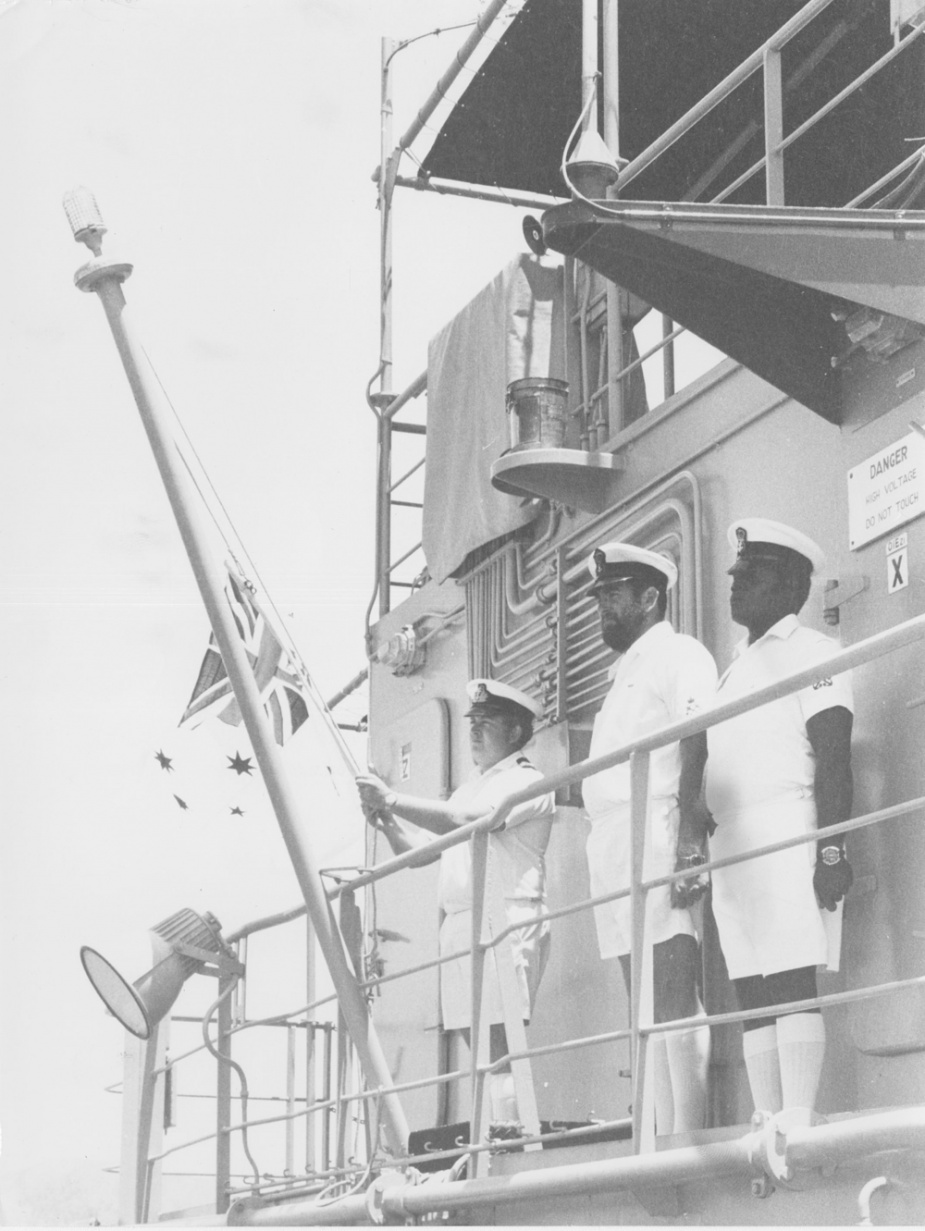 Australian White Ensign is lowered on HMAS Salamaua for the last time by its Commanding Officer, Lieutenant W.K. Scott. A few minutes later the Papua New Guinea Ensign was flying as the Landing Craft Heavy was re-commissioned into the Maritime Element of the Papua New Guinea Defence Force.