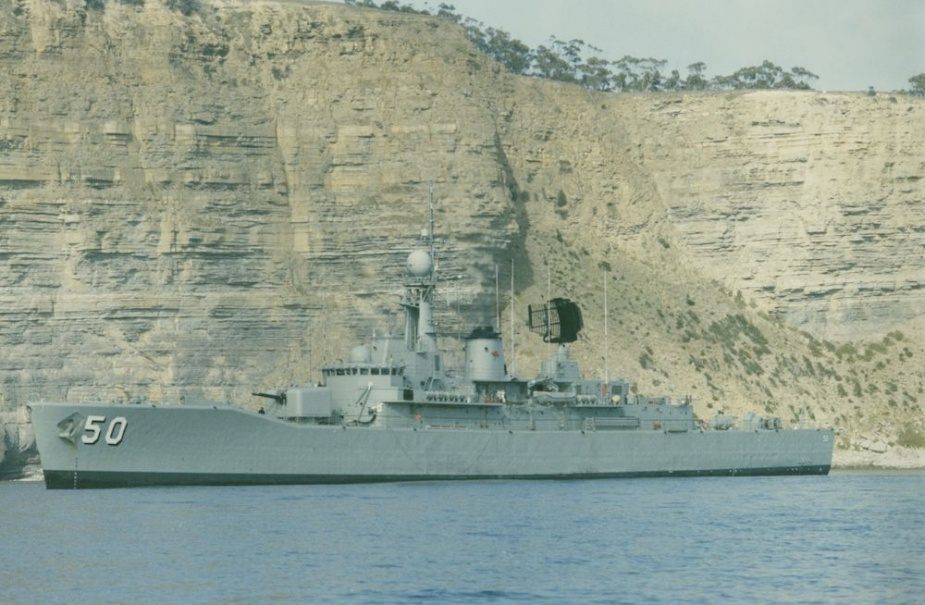 HMAS Swan seen beneath the towering cliffs of Fossil Bay, Maria Island off the south east coast of Tasmania. Photo: Lieutenant Evan Burton RAN