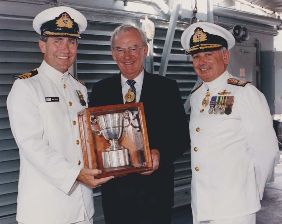 Commander KB Taylor, CSC, RAN accepts the Duke of Gloucester Cup on behalf of HMAS Tobruk's ship's company in 1993. Rear Admiral D. Chalmers, RAN looks on.