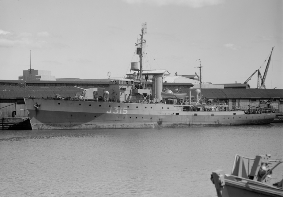 HMAS Wagga in Melbourne following her return to Australia in 1945. Note that she is riding high in the water, having been defuelled, as preparations are made to place her in Reserve status. (Allan C Green collection, State Library of Victoria)
