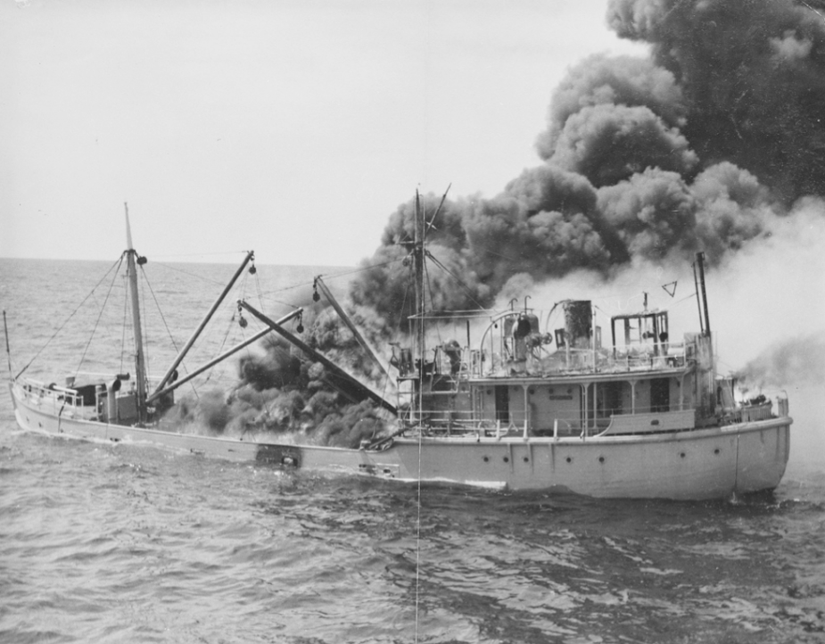 HMAS Woomera shortly after the explosion that set her alight.