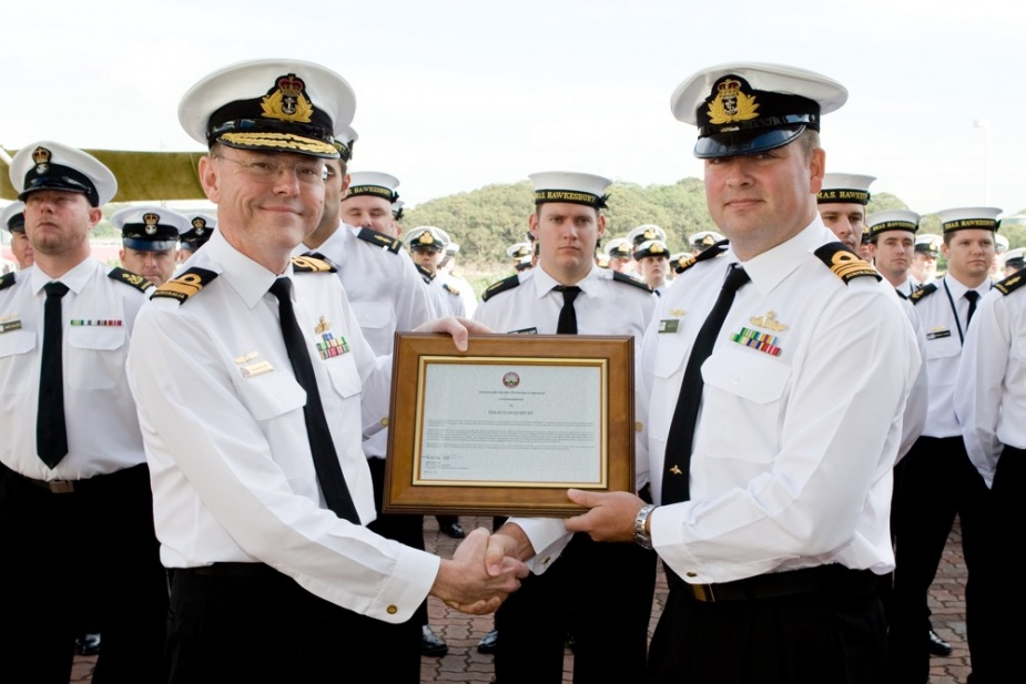 Commander Border Protection Command, Rear Admiral Allan du Toit, AM, RAN, (left) presents a Commendation to the Commanding Officer of HMAS Hawkesbury (II), Lieutenant Commander Ben Esler, RAN, for the ship's company's contribution to border security, 23 April 2009.