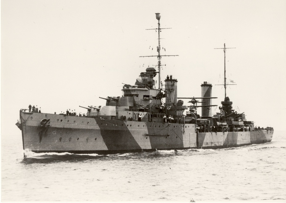 Following the Cape Spada action Sydney received her first disruptive camouflage paint scheme. 3/8-inch protective steel plate was also fitted around her 4-inch gun deck.
