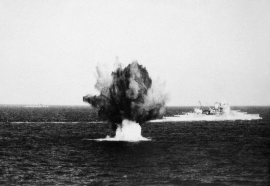HMS Warspite under fire in the Mediterranean.