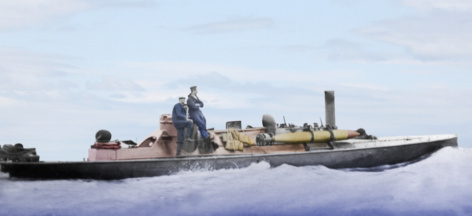 HMVS Lonsdale underway on Port Phillip Bay. Note the Whitehead torpedo secured in the torpedo dropping gear.